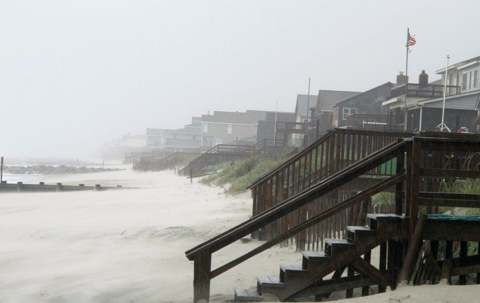 Heavy rains and wind from Hurricane Irene whip the sand on the beach at Pawleys Island, S.C., Friday, Aug. 26, 2011. Hurricane Irene began lashing the East Coast with rain Friday ahead of a weekend of violent weather that was almost certain to heap punishment on a vast stretch of shoreline from the Carolinas to Massachusetts. (AP Photo/Bruce Smith)