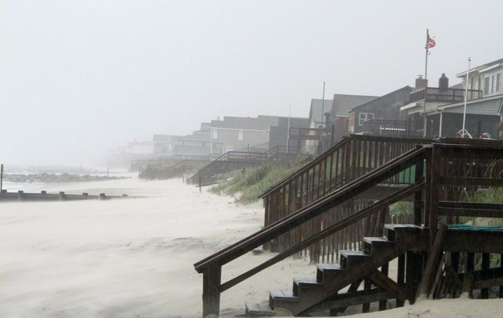 Heavy rains and wind from Hurricane Irene whip the sand on the beach at Pawleys Island, S.C., in 2011.