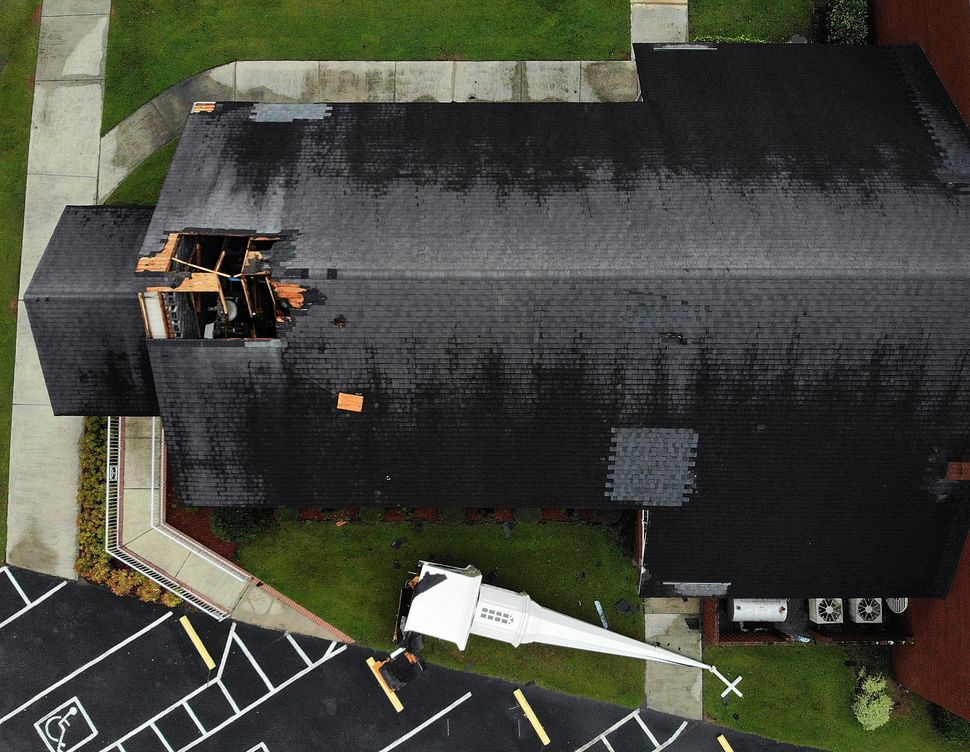 A steeple lies next to the Elah Baptist Church after being blown off by the strong winds of Hurricane Florence in Leland, Nor