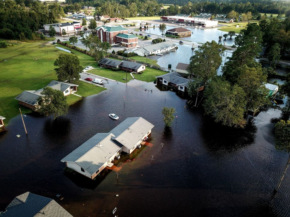 A flooded neighborhood stands next to the Lumber River in Pembroke, North Carolina.