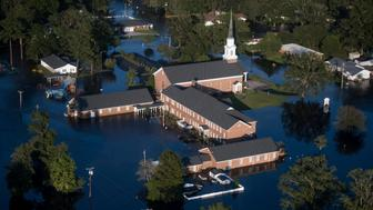 Floodwaters inundate a church after Hurricane Florence struck the Carolinas Monday, Sept. 17, 2018, in Conway, S.C. (AP Photo/Sean Rayford)