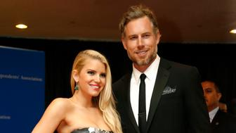 Actors Jessica Simpson and Eric Johnson arrive on the red carpet at the annual White House Correspondents' Association Dinner in Washington, May 3, 2014.  REUTERS/Jonathan Ernst (UNITED STATES  - Tags: POLITICS MEDIA ENTERTAINMENT SOCIETY)