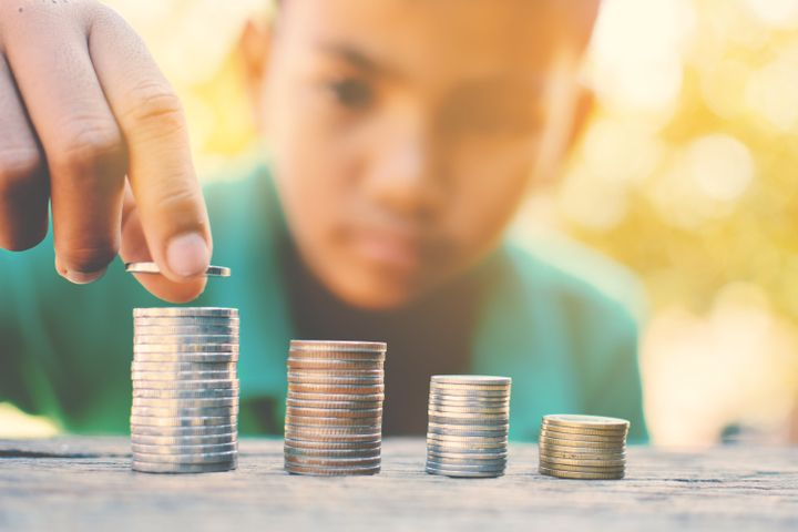 It's important to teach kids the concept of money early on. Here's how to do it.