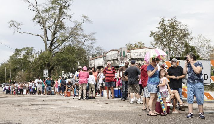 Dozens of people in Wilmington, North Carolina, wait in line for ice on Sept. 17, after Hurricane Florence hit. The storm&rsq