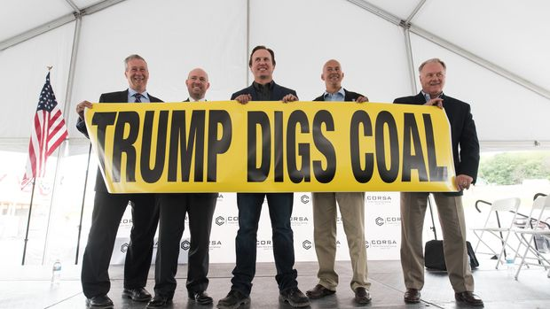 FRIEDENS, PA - JUNE 08: (from left to right) Ron Aldom, executive director of the Somerset County Chamber of Commerce, Carl Metzgar, PA State Representative, George Dethlefsen, CEO Corsa Coal Corp., Pat Stefano, PA State Senator, and Scott Wagner, PA State Senator hold up a 'Trump Digs Coal' sign at the grand opening of Corsa Coal's Acosta Deep Mine on June 8, 2017 in Friedens, Pennsylvania. The mine is expected to create more than 70 new jobs and should produce 400,000 tons of metallurgical coal a year. (Photo by Justin Merriman/Getty Images)
