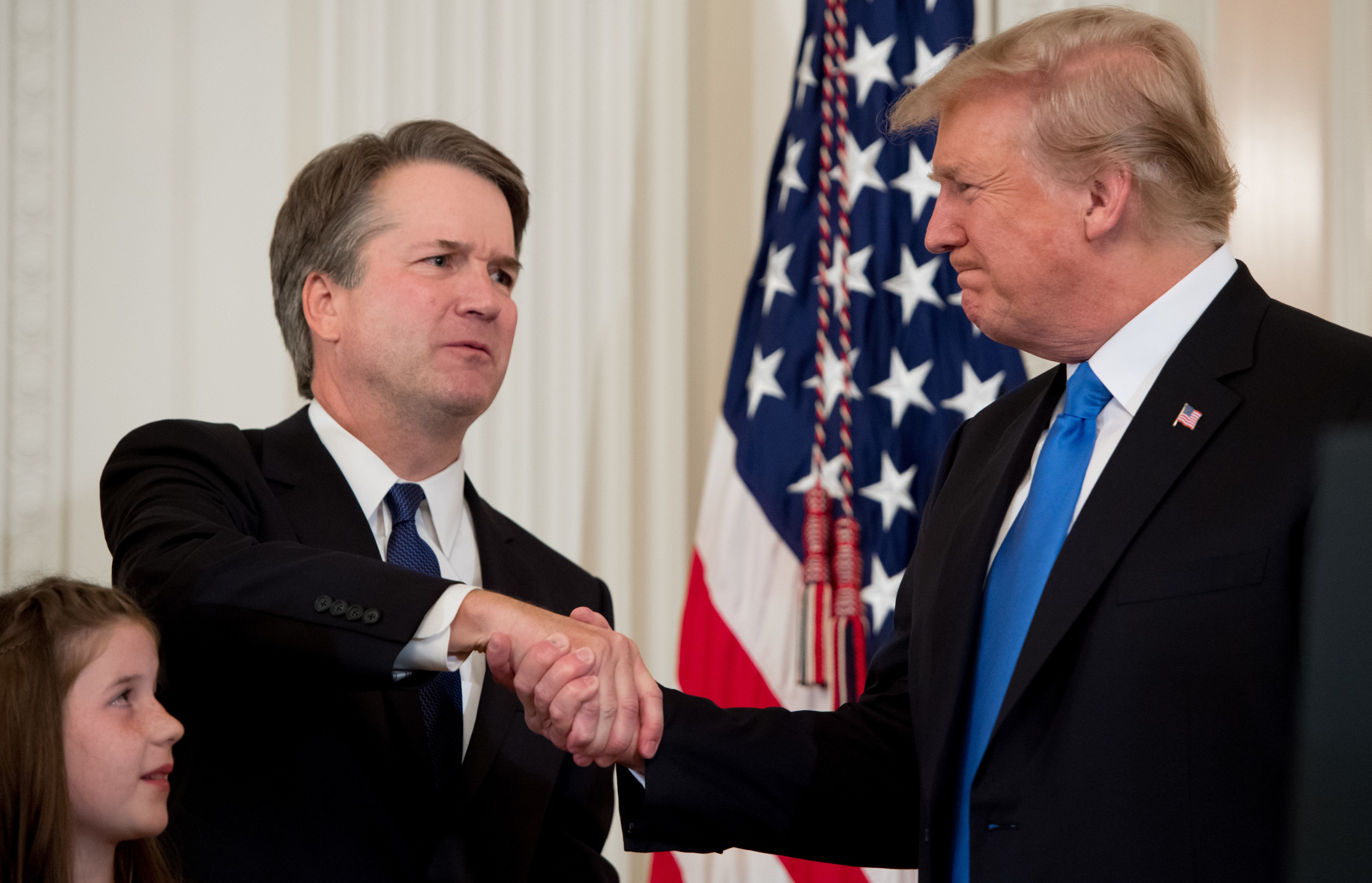 TOPSHOT - US Judge Brett Kavanaugh (L) shakes hands with US President Donald Trump after being nominated to the Supreme Court in the East Room of the White House on July 9, 2018 in Washington, DC. (Photo by SAUL LOEB / AFP)        (Photo credit should read SAUL LOEB/AFP/Getty Images)