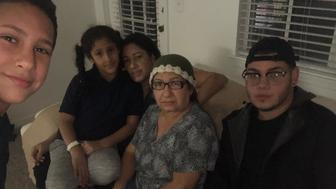 Amneris Ortiz her mother and three kids in their rental apartment