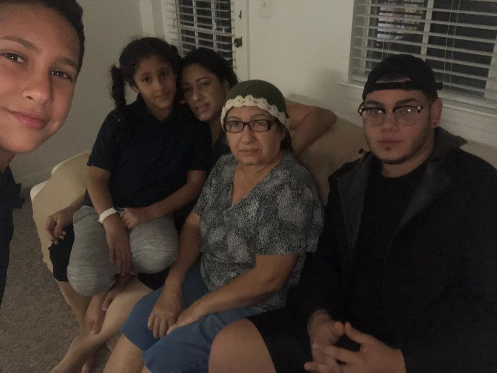 Amneris Ortiz, her mother and three kids in their rental apartment