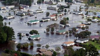Houses sit in floodwater caused by Hurricane Florence, in this aerial picture, on the outskirts of Lumberton, North Carolina, U.S. September 17, 2018. REUTERS/Jason Miczek      TPX IMAGES OF THE DAY