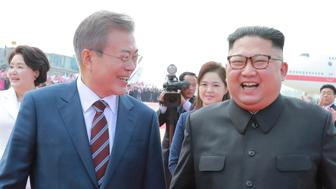 South Korean President Moon Jae-in and North Korean leader Kim Jong Un attend an official welcome ceremony at Pyongyang Sunan International Airport in Pyongyang, North Korea in this photo released by North Korea's Korean Central News Agency (KCNA) September 19, 2018. KCNA/via REUTERS  ATTENTION EDITORS - THIS PICTURE WAS PROVIDED BY A THIRD PARTY. REUTERS IS UNABLE TO INDEPENDENTLY VERIFY THE AUTHENTICITY, CONTENT, LOCATION OR DATE OF THIS IMAGE. NO THIRD PARTY SALES. NOT FOR USE BY REUTERS THIRD PARTY DISTRIBUTORS. SOUTH KOREA OUT.