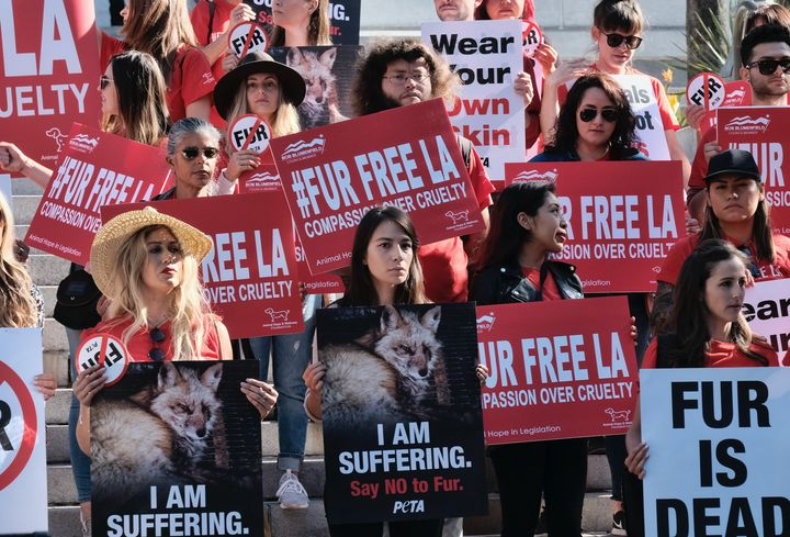 Protesters call for the ban of fur sales in front of City Hall in Los Angeles on Tuesday.