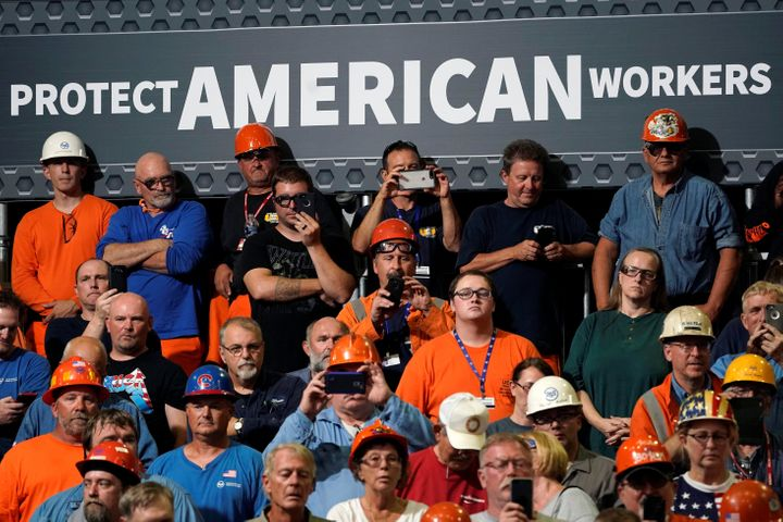 Steelworkers watch as President Donald Trump discusses trade in Granite City, Illinois, U.S., on July 26, 2018.