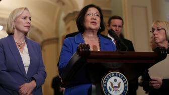 U.S. Senator Mazie Hirono speaks with Senators Kirsten Gillibrand Patty Murray at her sides about the Supreme Court nomination of Judge Brett Kavanaugh and the sexual assault accusation against Kavanaugh from 36 years ago, at the U.S. Capitol on Capitol Hill in Washington, U.S., September 18, 2018. REUTERS/Mike Segar