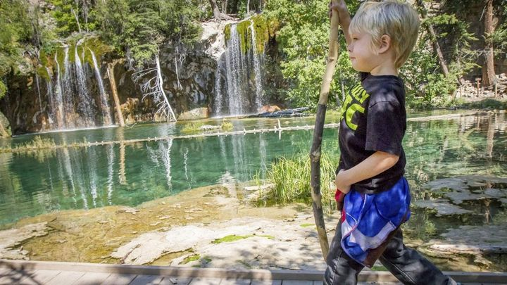 Ethan Patterson, 5, walks along the boardwalk after making the trek up to Hanging Lake in Glenwood Canyon, Colorado. Up to 1,
