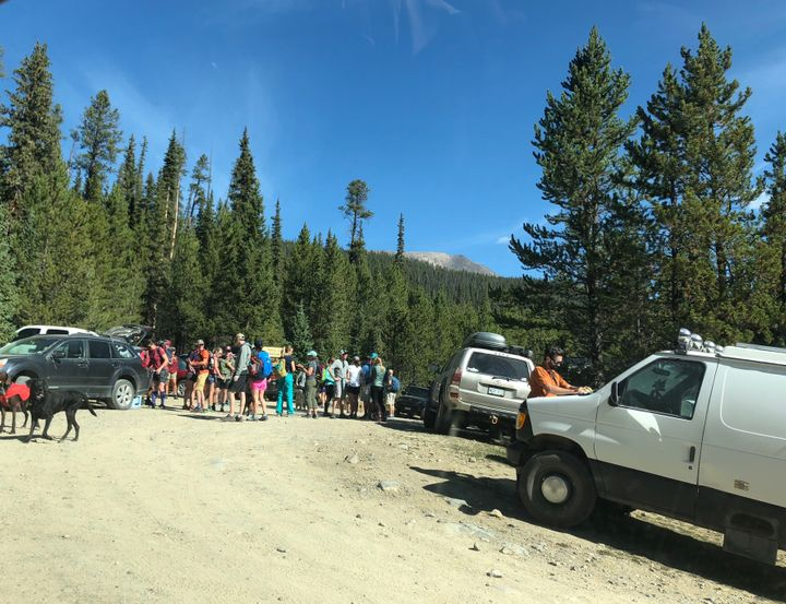 The crowded parking area at the start of the Fancy Lake trail this month. Towns and counties in the area are pitching in to h