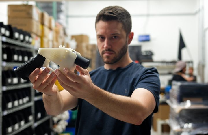 Cody Wilson poses with a 3D-printed gun in his factory in Austin, Texas, on Aug. 1, 2018. Austin authorities charged Wilson w