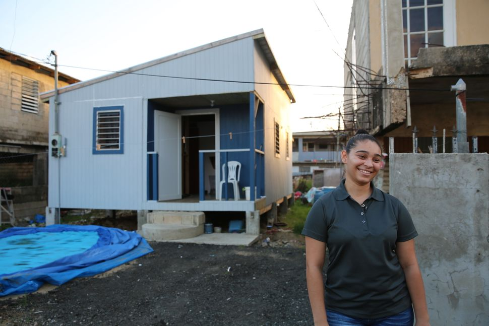 A year later, Acevedo is chipper as she talks about her new home. Built by a nonprofit organization, the house sits next door