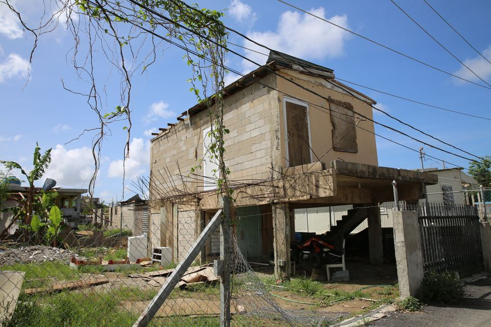 Before the hurricane, Keishla Acevedo lived in her grandmother's home with her husband and son. The house, pictured here