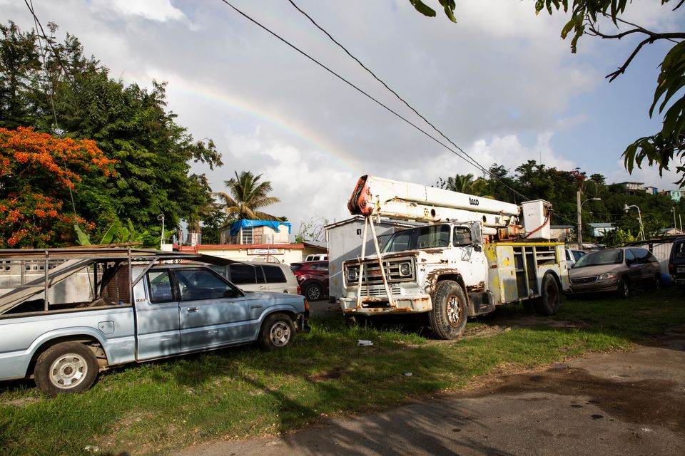Carrion raised $2,500 from local residents and bought a used bucket truck (right), with which he and...
