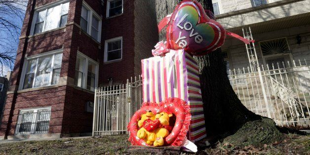 A makeshift memorial is seen in Chicago, Tuesday, March 12, 2013, at the site where 6-month-old girl Jonylah Watkins, and her