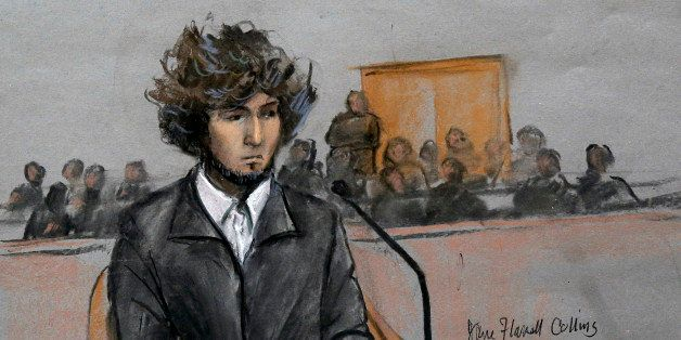 In this courtroom sketch, Boston Marathon bombing suspect Dzhokhar Tsarnaev is depicted sitting in federal court in Boston Th