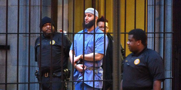 Officials escort 'Serial' podcast subject Adnan Syed from the courthouse following the completion of the first day of hearing