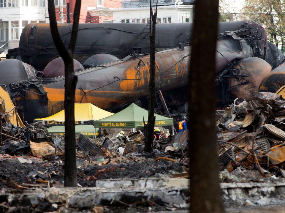 Work continues at the crash site of the train derailment and fire in Lac-Megantic, Que., on Tuesday, July 16, 2013, that left