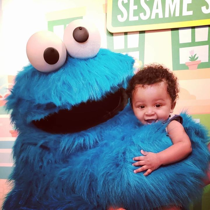 Malcolm with Cookie Monster.