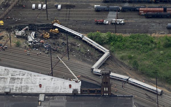 Emergency personnel work at the scene of a deadly train derailment, Wednesday, May 13, 2015, in Philadelphia.