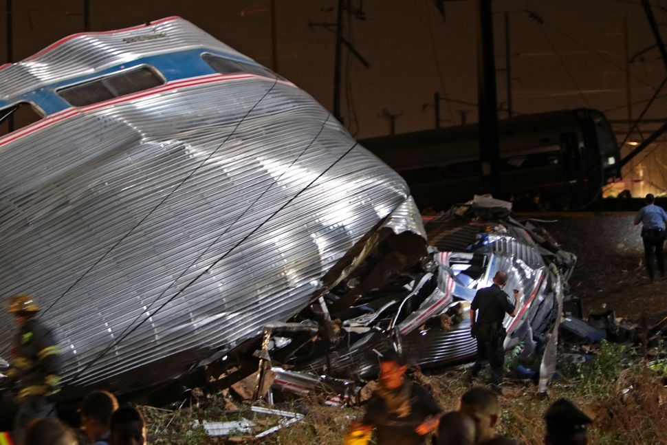Emergency personnel work the scene of a deadly train wreck, Tuesday, May 12, 2015, in Philadelphia. An Amtrak train headed to