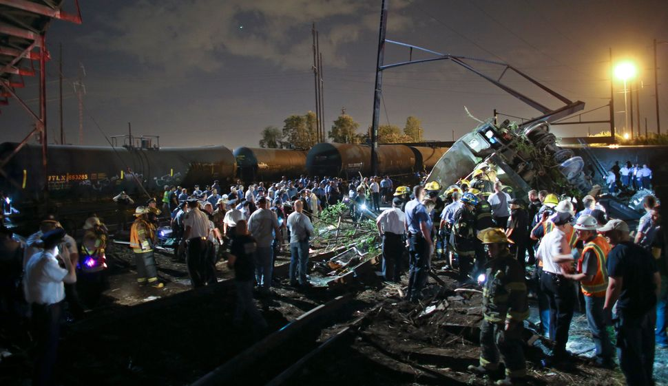 Emergency personnel work the scene of a train wreck, Tuesday, May 12, 2015, in Philadelphia.