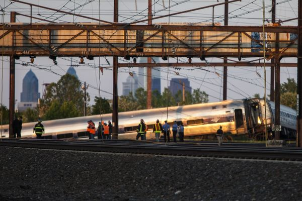 Rescue crews and investigators inspect the site of an Amtrak train derailment in Philadelphia on May 13, 2015. At least five