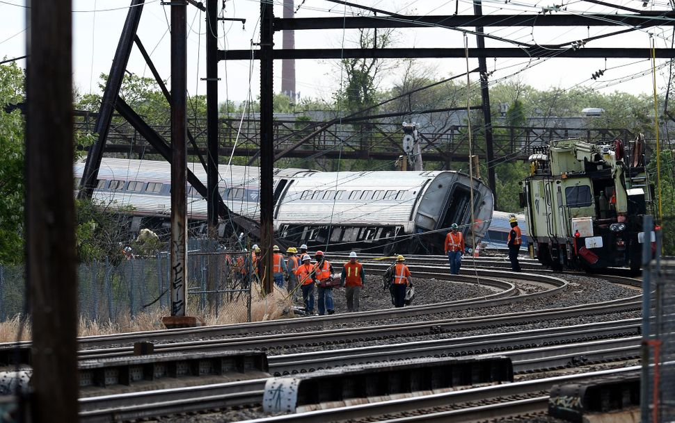 Rescuers work around derailed carriages of an Amtrak train in Philadelphia, Pennsylvania, on May 13, 2015.
