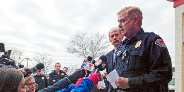 Albuquerque, N.M., Police Chief Gorden Eden, right, speaks to reporters as Albuquerque Mayor Richard Berry, left, listens to