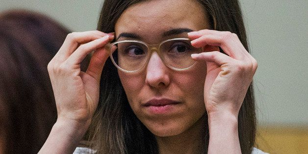 Jodi Arias adjusts her glasses during her sentencing retrial at Maricopa County Superior Court, Wednesday, Feb. 18, 2015, in