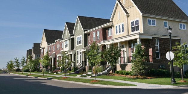 Perfectly manicured row of suburban townhouses on a beautiful summer day.