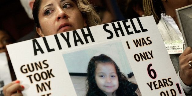 WASHINGTON, DC - SEPTEMBER 18:  Diana Aguilar holds a photo of her 6 year old daughter Aliyah Shell during a press conference