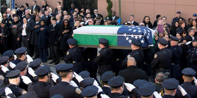 NEW YORK, NY - DECEMBER 27:  Pallbearers carry the casket during the funeral of slain New York Police Department (NYPD) offic