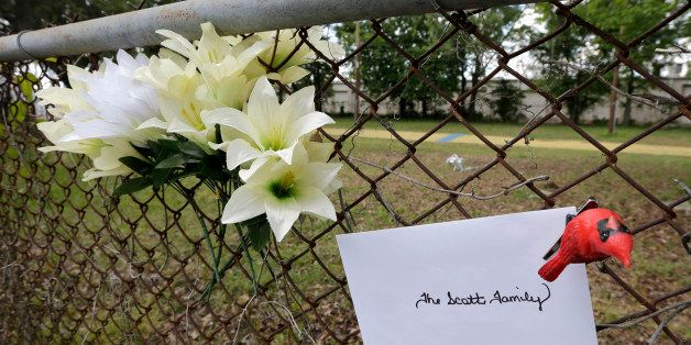 Memorials are placed near the site where Walter Scott was killed in North Charleston, S.C., Wednesday, April 8, 2015. Scott w