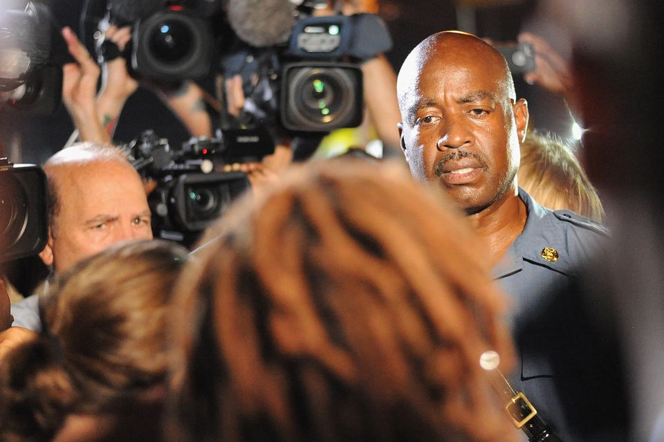 Captain Ron Johnson of the Missouri Highway Patrol speaks to media during a protest on West Florissant Avenue in Ferguson, Mi