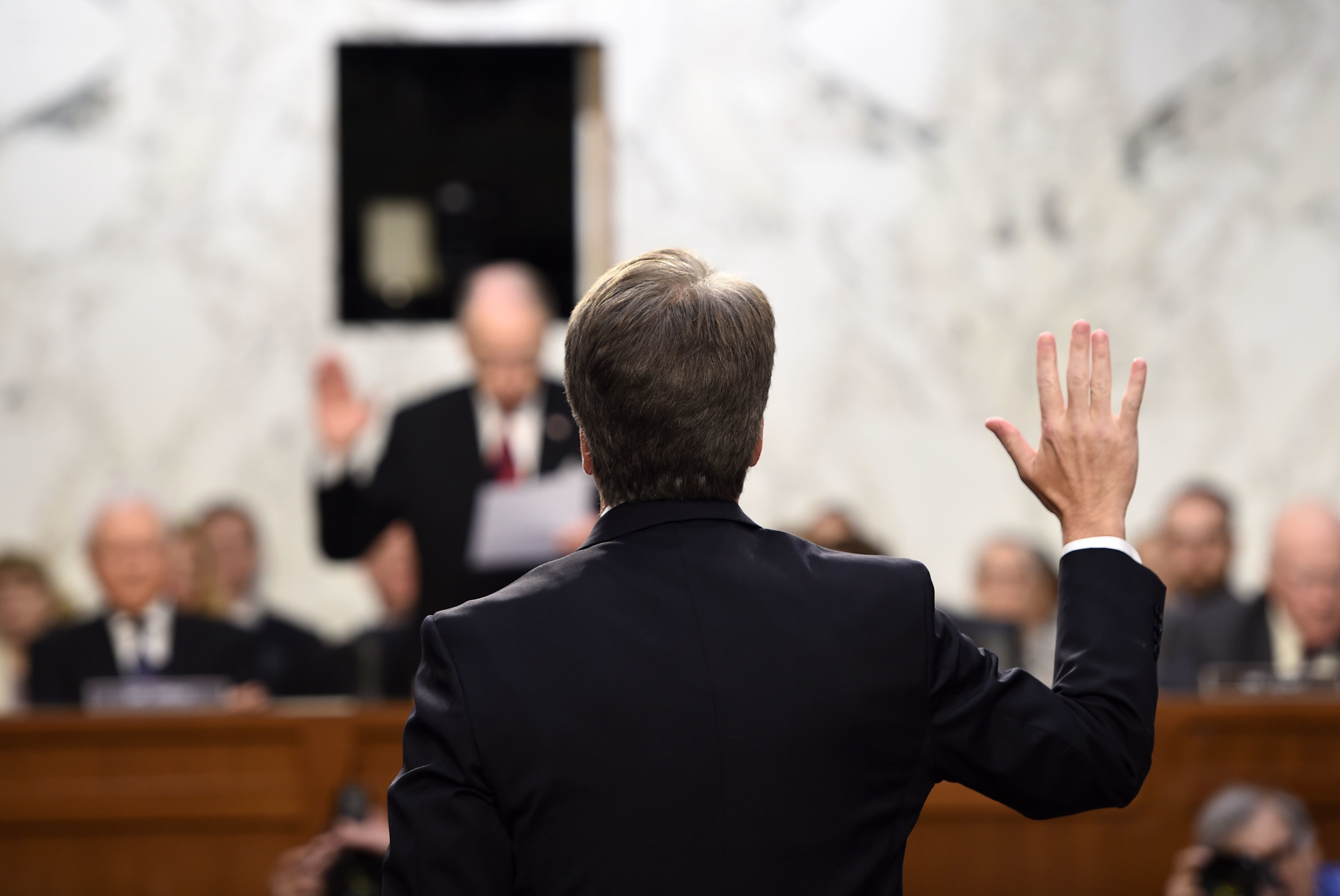 Kavanaugh is sworn in by the Chairman of the U.S. Senate Judiciary Committee Chuck Grassley, during his U.S. Senate Judiciary