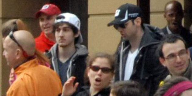 This Monday, April 15, 2013 photo provided by Bob Leonard shows bombing suspects Tamerlan Tsarnaev, 26, center right in black hat, and his brother, Dzhokhar A. Tsarnaev, 19, center left in white hat, approximately 10-20 minutes before the blasts that struck the Boston Marathon. (AP Photo/Bob Leonard)