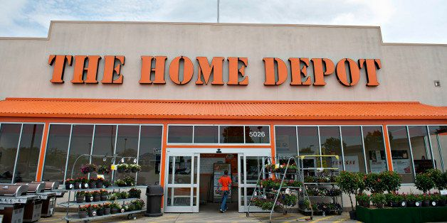 A U.S. flag flies above the entrance of a Home Depot Inc. store in Peoria, Illinois, U.S., on Monday, May 19, 2014. Home Depo