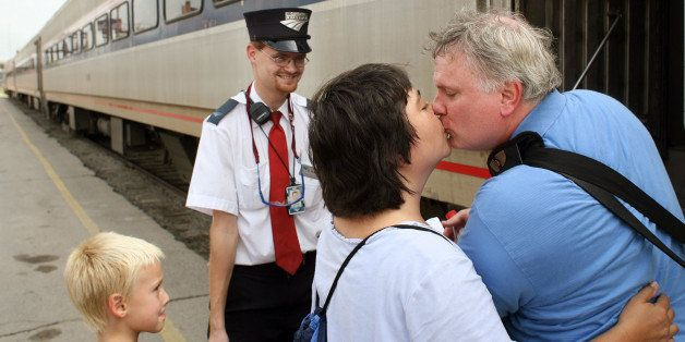 Amtrak assistant conductor Brandon Bostian stands by on Aug. 21, 2007 as Sandra Palmer of University City says goodbye to her
