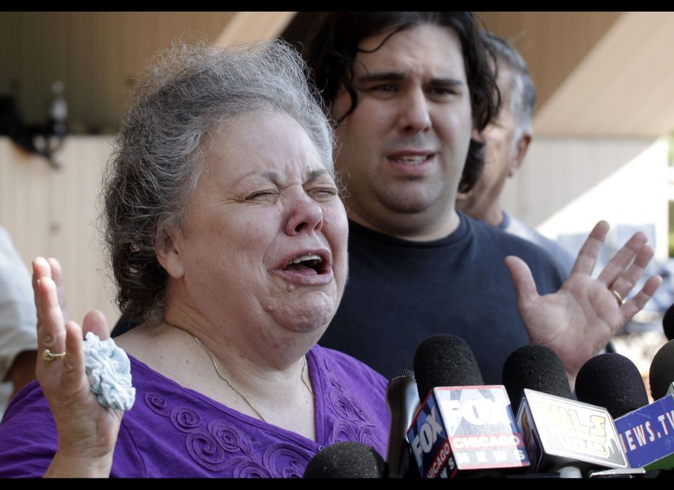 Marcia Savio, step-mother of Kathleen Savio cries outside the Will County Courthouse after word that former Bolingbrook polic