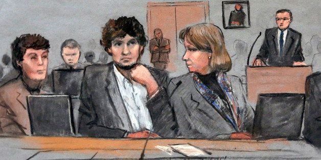 FILE - In this March 5, 2015 file courtroom sketch, Dzhokhar Tsarnaev, center, is depicted between defense attorneys Miriam C
