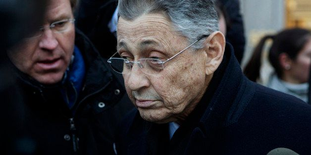 Sheldon Silver, New York state assembly speaker, is surrounded by members of the media while exiting federal court in New Yor