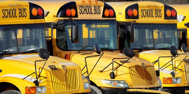 Public school buses are parked unused Wednesday, Jan. 7, 2015, in Springfield, Ill., as schools closed and warming shelters o