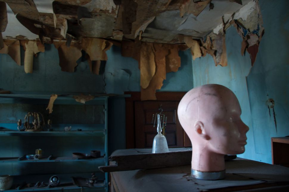 The Doll House Mansion (Philadelphia, PA) is an abandoned mansion full of nothing but dolls and organized metal saws and tool