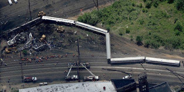 PHILADELPHIA, PA - MAY 13:  Investigators and first responders work near the wreckage of Amtrak Northeast Regional Train 188,